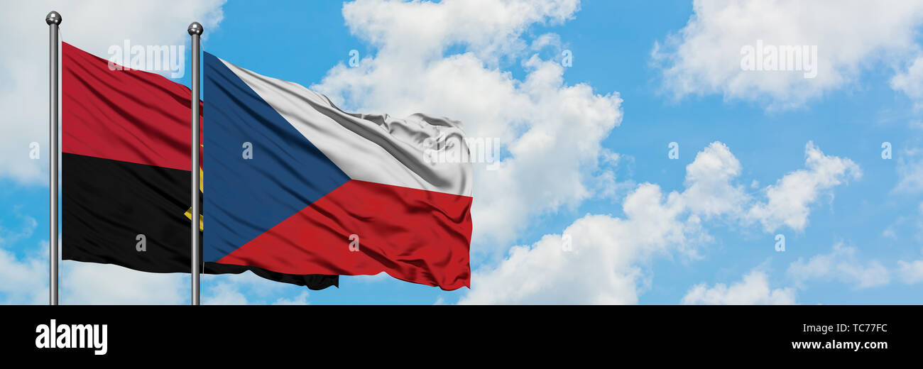 Angola and Czech Republic flag waving in the wind against white cloudy blue sky together. Diplomacy concept, international relations. - Stock Image