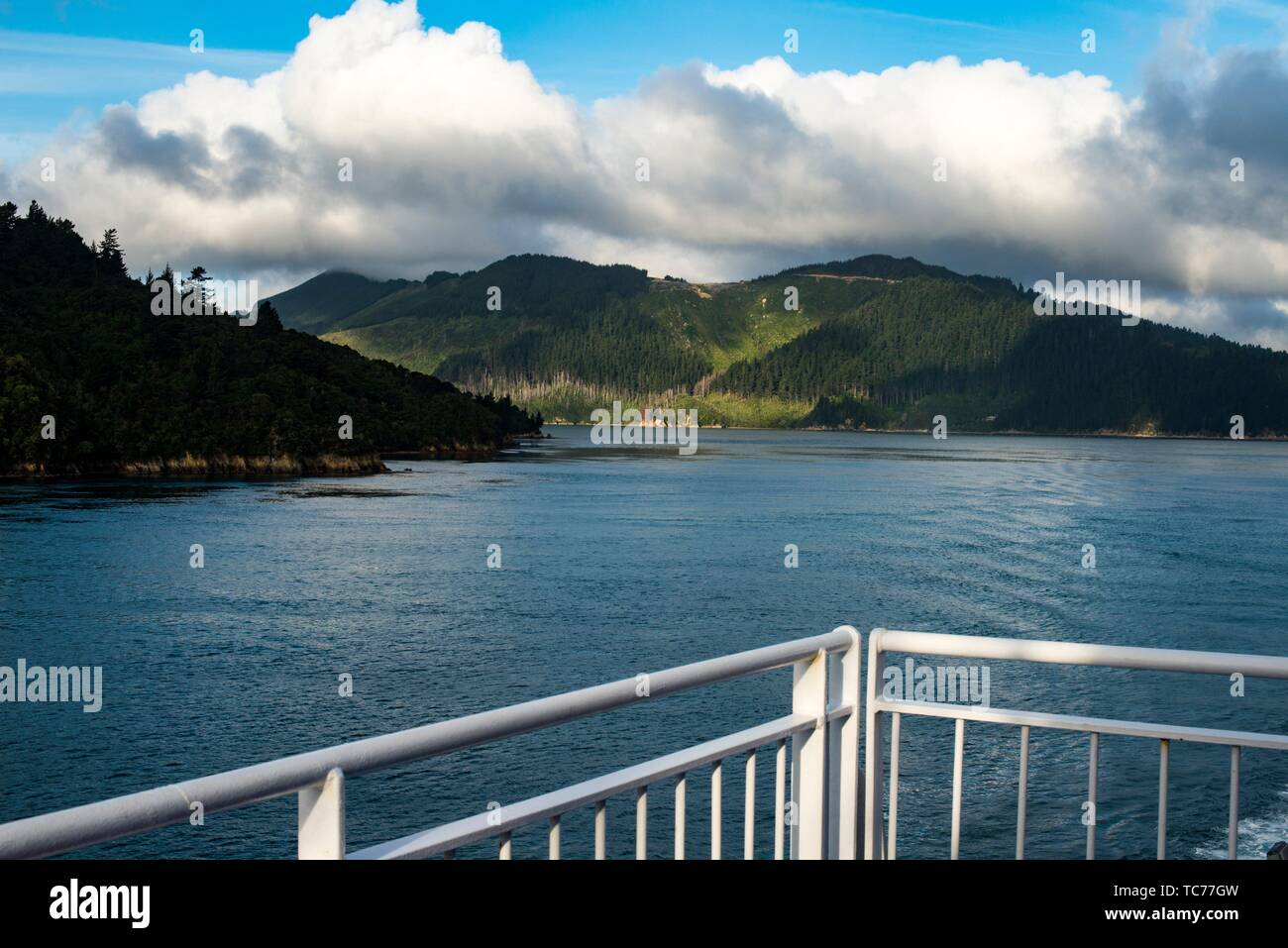 view from the ferry boat in Queen Charlotte Sound as it approaches Picton on the south island of New Zealand. - Stock Image