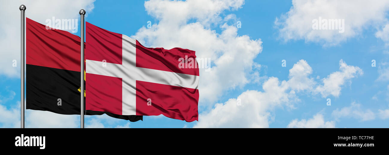 Angola and Denmark flag waving in the wind against white cloudy blue sky together. Diplomacy concept, international relations. - Stock Image