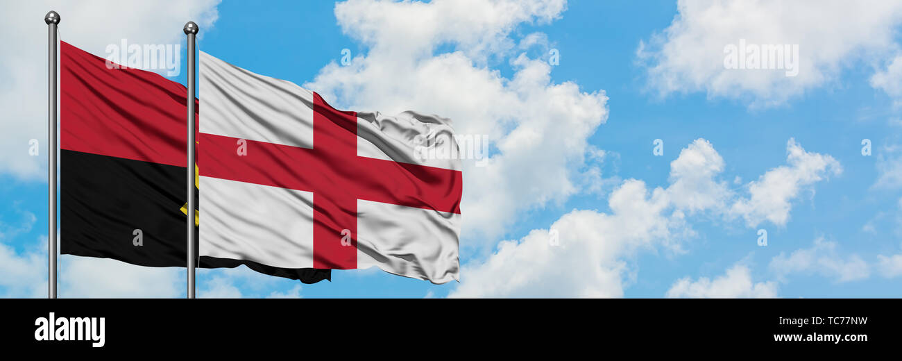 Angola and England flag waving in the wind against white cloudy blue sky together. Diplomacy concept, international relations. - Stock Image