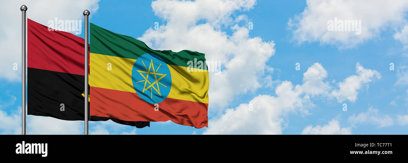 Angola and Ethiopia flag waving in the wind against white cloudy blue sky together. Diplomacy concept, international relations. - Stock Image