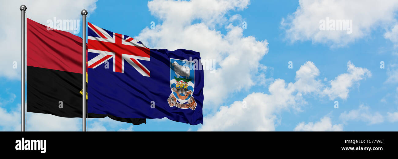 Angola and Falkland Islands flag waving in the wind against white cloudy blue sky together. Diplomacy concept, international relations. - Stock Image