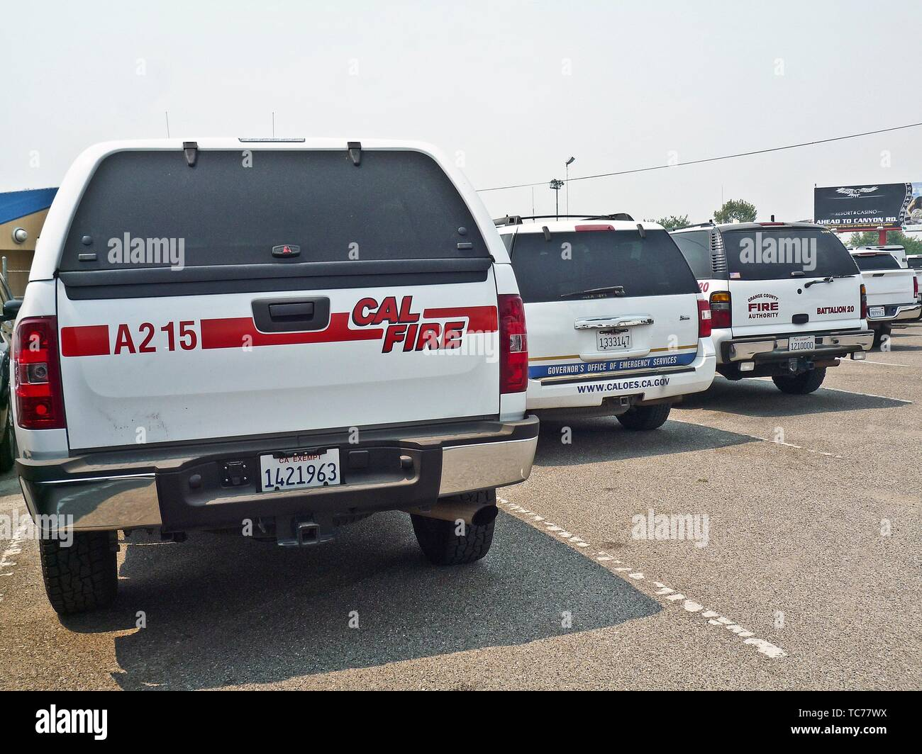 Fire support vehicles parked at a staging area in the Shasta County Fair Grounds in Anderson, California during the Carr Fire of 2018. - Stock Image