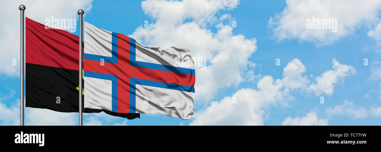 Angola and Faroe Islands flag waving in the wind against white cloudy blue sky together. Diplomacy concept, international relations. - Stock Image