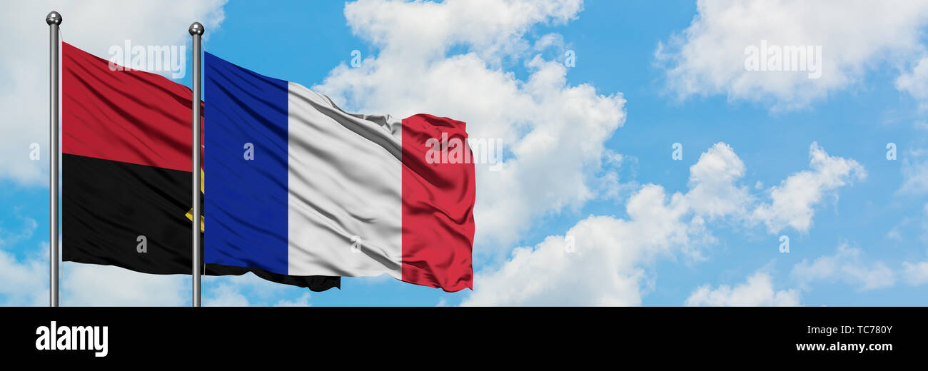 Angola and France flag waving in the wind against white cloudy blue sky together. Diplomacy concept, international relations. - Stock Image