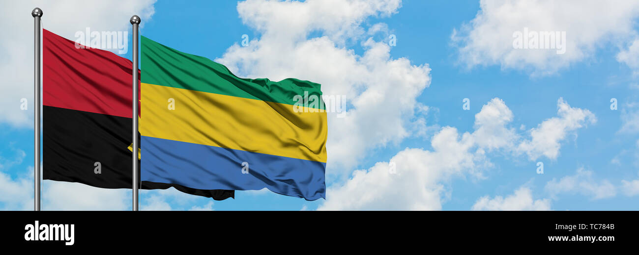 Angola and Gabon flag waving in the wind against white cloudy blue sky together. Diplomacy concept, international relations. - Stock Image