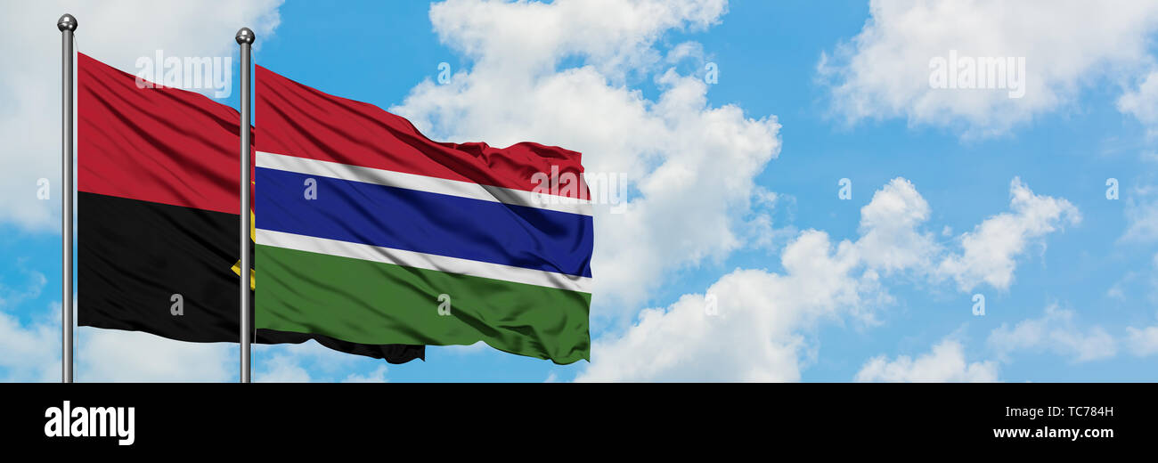 Angola and Gambia flag waving in the wind against white cloudy blue sky together. Diplomacy concept, international relations. - Stock Image