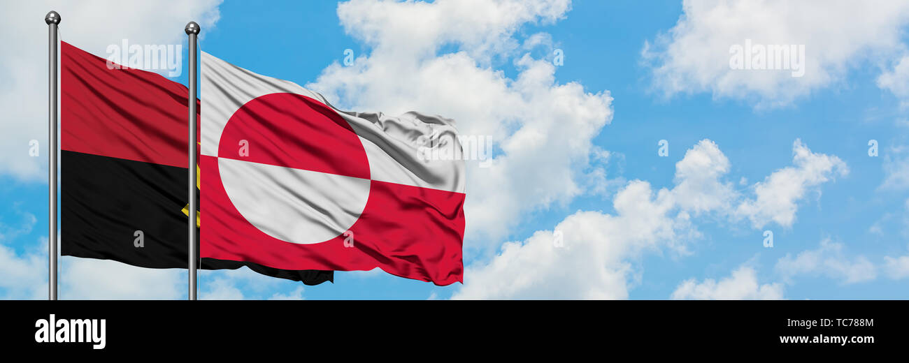 Angola and Greenland flag waving in the wind against white cloudy blue sky together. Diplomacy concept, international relations. - Stock Image