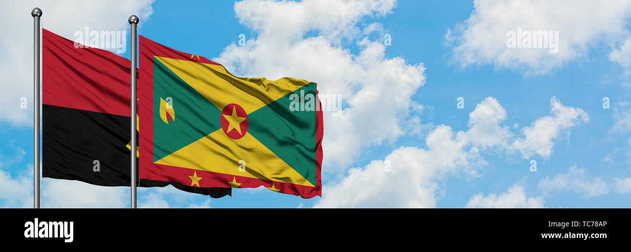Angola and Grenada flag waving in the wind against white cloudy blue sky together. Diplomacy concept, international relations. - Stock Image