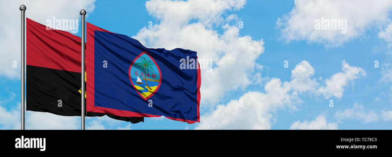 Angola and Guam flag waving in the wind against white cloudy blue sky together. Diplomacy concept, international relations. - Stock Image