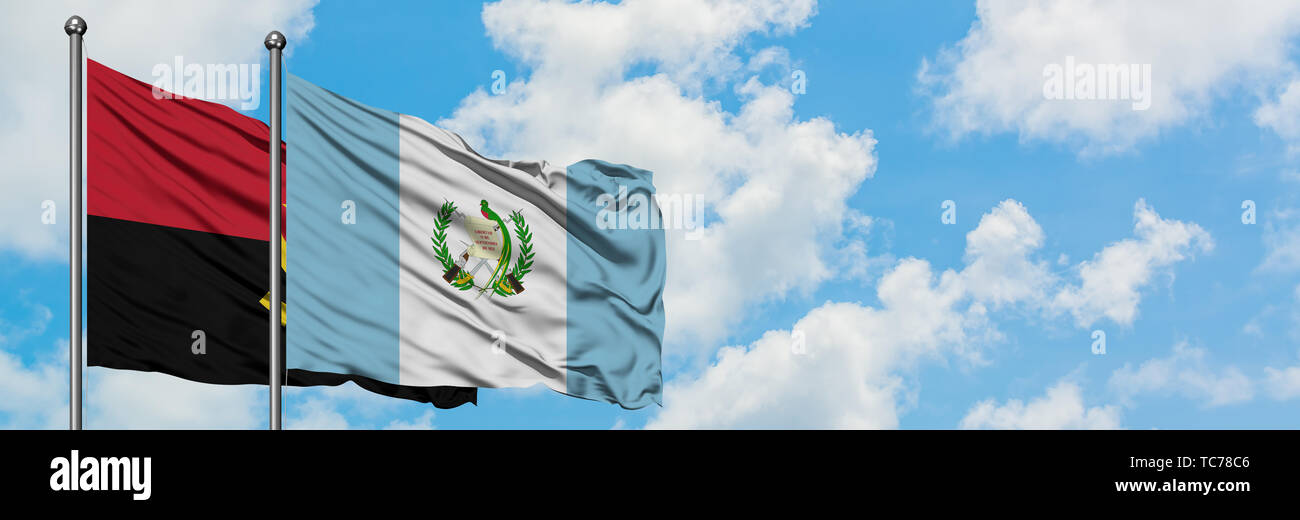 Angola and Guatemala flag waving in the wind against white cloudy blue sky together. Diplomacy concept, international relations. - Stock Image