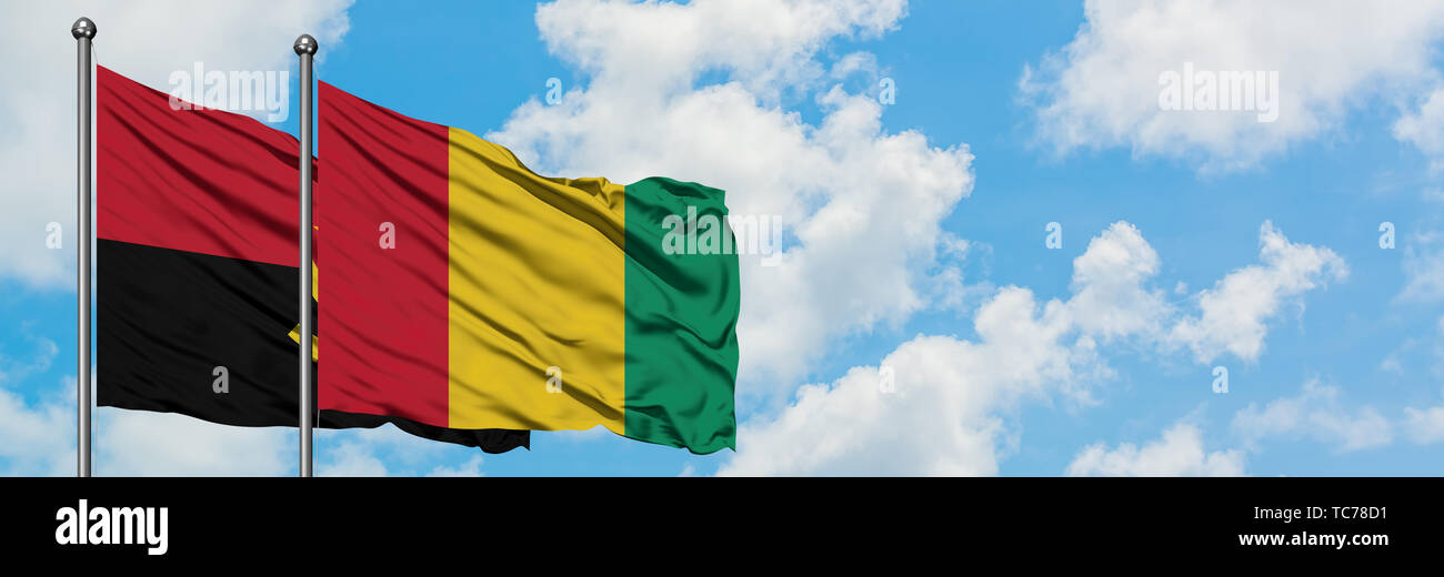 Angola and Guinea flag waving in the wind against white cloudy blue sky together. Diplomacy concept, international relations. - Stock Image