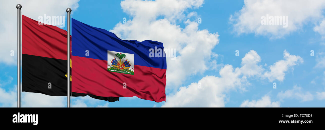 Angola and Haiti flag waving in the wind against white cloudy blue sky together. Diplomacy concept, international relations. - Stock Image