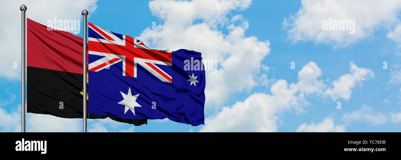 Angola and Heard Island and Mcdonald Islands flag waving in the wind against white cloudy blue sky together. Diplomacy concept, international relation - Stock Image