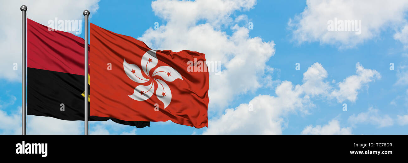 Angola and Hong Kong flag waving in the wind against white cloudy blue sky together. Diplomacy concept, international relations. - Stock Image