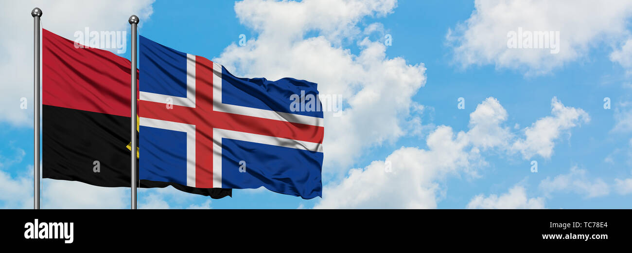 Angola and Iceland flag waving in the wind against white cloudy blue sky together. Diplomacy concept, international relations. - Stock Image