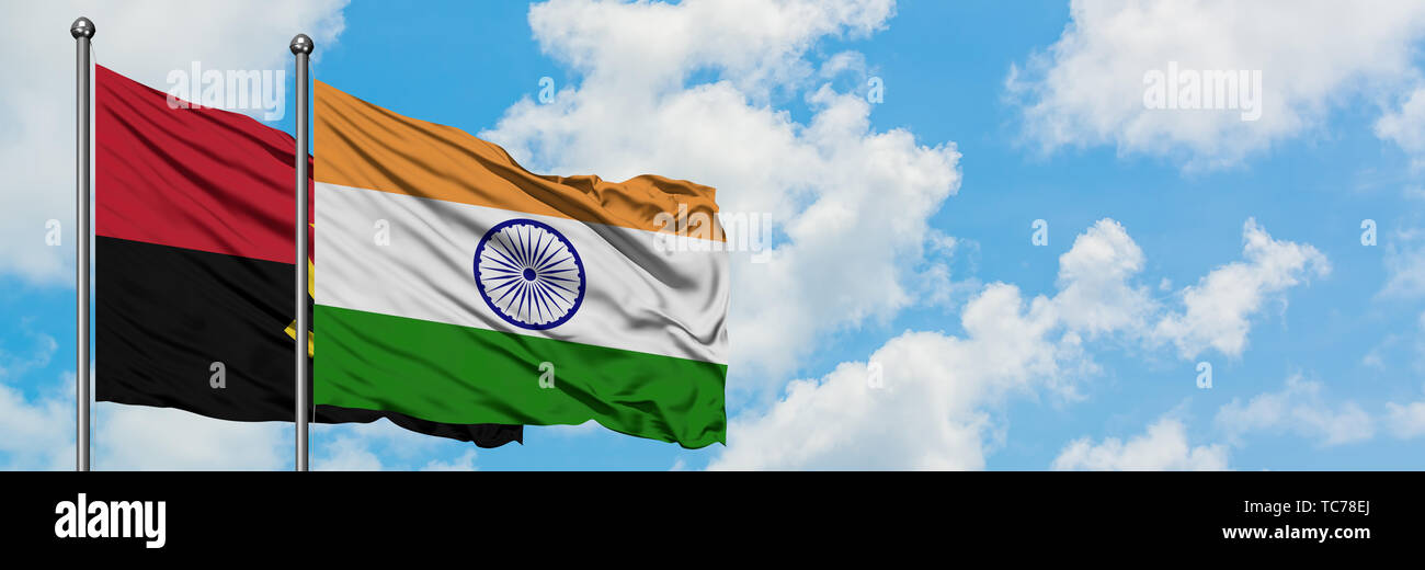 Angola and India flag waving in the wind against white cloudy blue sky together. Diplomacy concept, international relations. - Stock Image