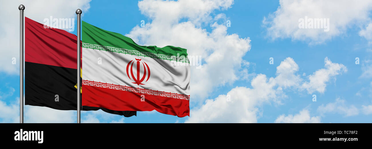 Angola and Iran flag waving in the wind against white cloudy blue sky together. Diplomacy concept, international relations. - Stock Image