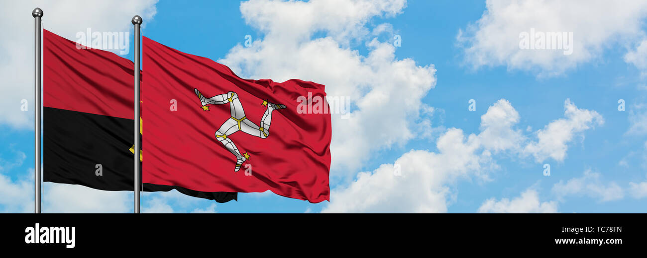 Angola and Isle Of Man flag waving in the wind against white cloudy blue sky together. Diplomacy concept, international relations. - Stock Image