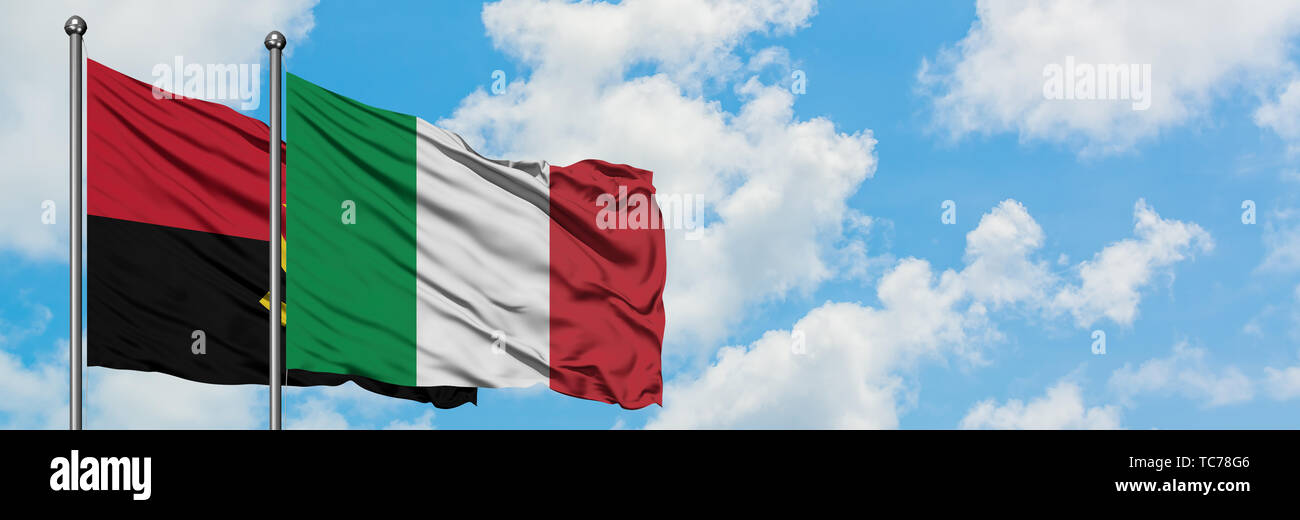 Angola and Italy flag waving in the wind against white cloudy blue sky together. Diplomacy concept, international relations. - Stock Image