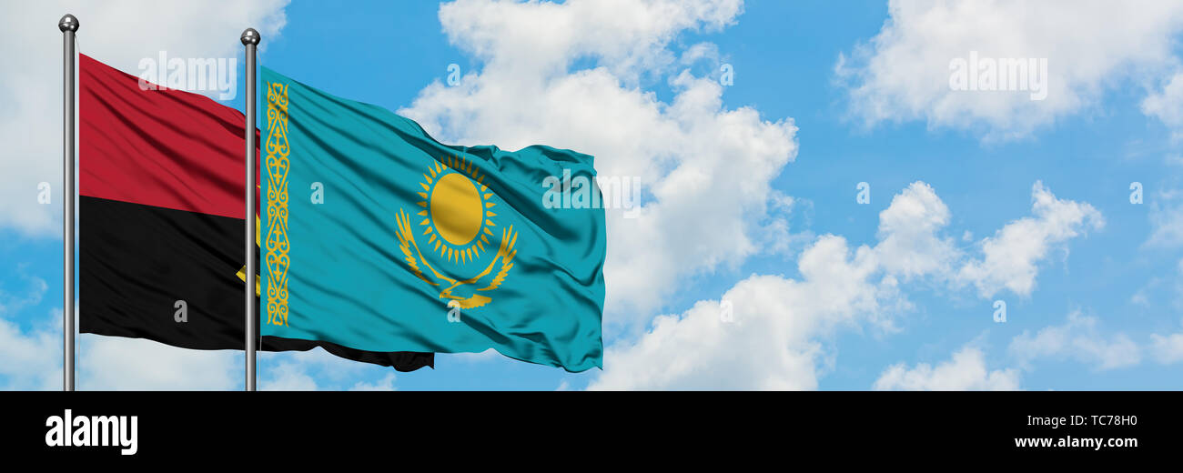 Angola and Kazakhstan flag waving in the wind against white cloudy blue sky together. Diplomacy concept, international relations. - Stock Image