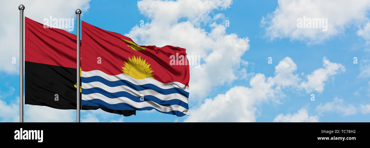 Angola and Kiribati flag waving in the wind against white cloudy blue sky together. Diplomacy concept, international relations. - Stock Image