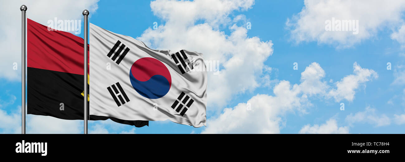 Angola and South Korea flag waving in the wind against white cloudy blue sky together. Diplomacy concept, international relations. - Stock Image