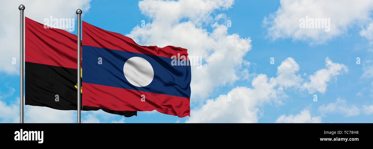 Angola and Laos flag waving in the wind against white cloudy blue sky together. Diplomacy concept, international relations. - Stock Image