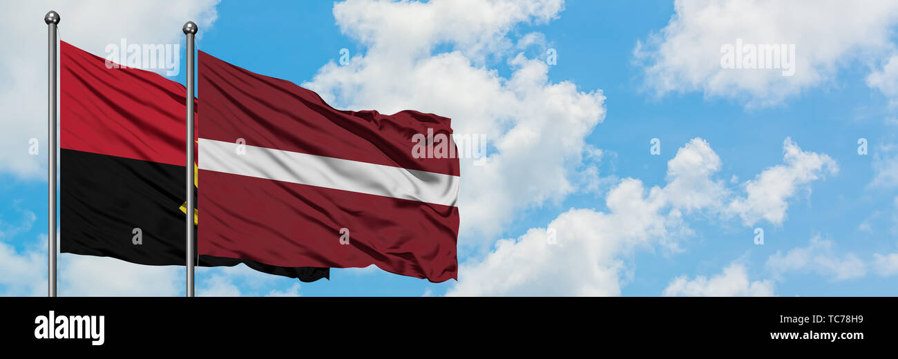 Angola and Latvia flag waving in the wind against white cloudy blue sky together. Diplomacy concept, international relations. - Stock Image