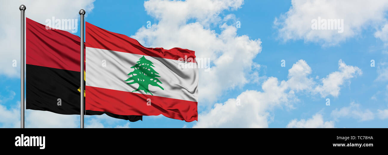 Angola and Lebanon flag waving in the wind against white cloudy blue sky together. Diplomacy concept, international relations. - Stock Image
