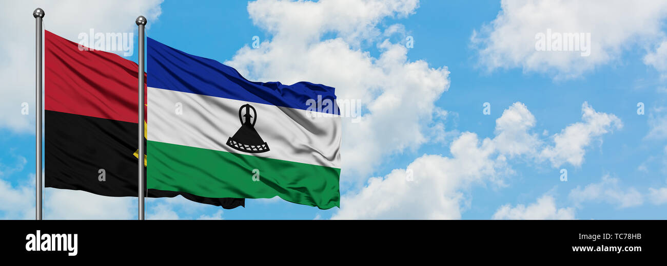 Angola and Lesotho flag waving in the wind against white cloudy blue sky together. Diplomacy concept, international relations. - Stock Image