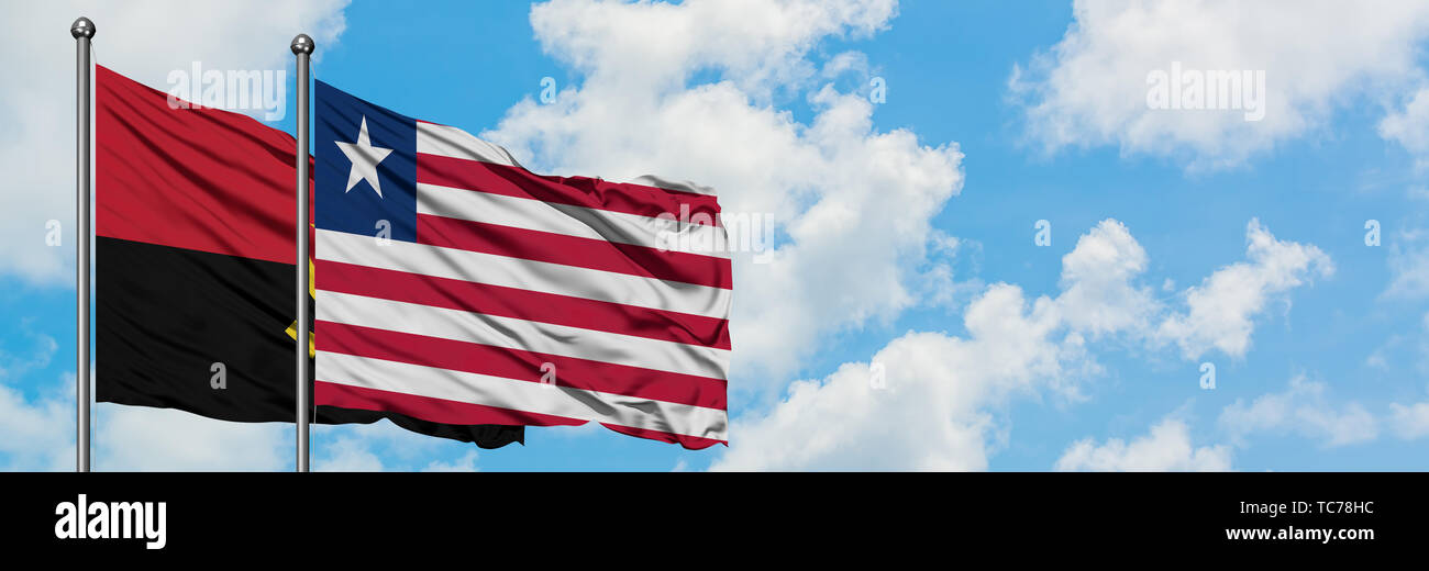 Angola and Liberia flag waving in the wind against white cloudy blue sky together. Diplomacy concept, international relations. - Stock Image