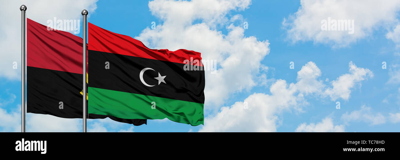 Angola and Libya flag waving in the wind against white cloudy blue sky together. Diplomacy concept, international relations. - Stock Image