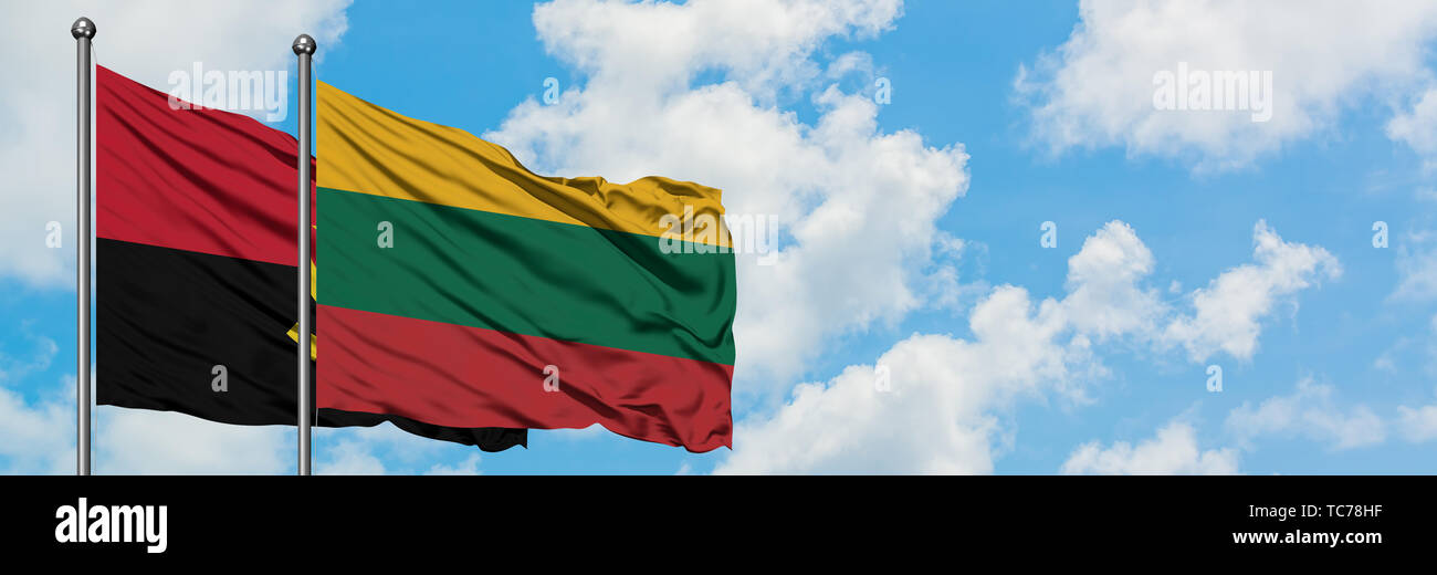 Angola and Lithuania flag waving in the wind against white cloudy blue sky together. Diplomacy concept, international relations. - Stock Image