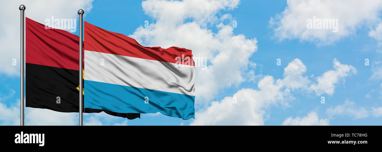 Angola and Luxembourg flag waving in the wind against white cloudy blue sky together. Diplomacy concept, international relations. - Stock Image