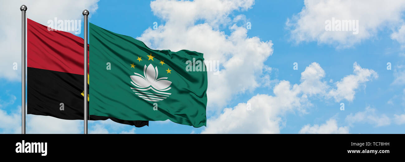 Angola and Macao flag waving in the wind against white cloudy blue sky together. Diplomacy concept, international relations. - Stock Image
