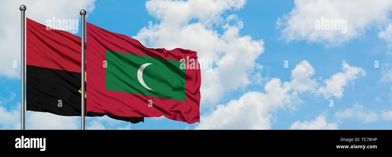 Angola and Maldives flag waving in the wind against white cloudy blue sky together. Diplomacy concept, international relations. - Stock Image