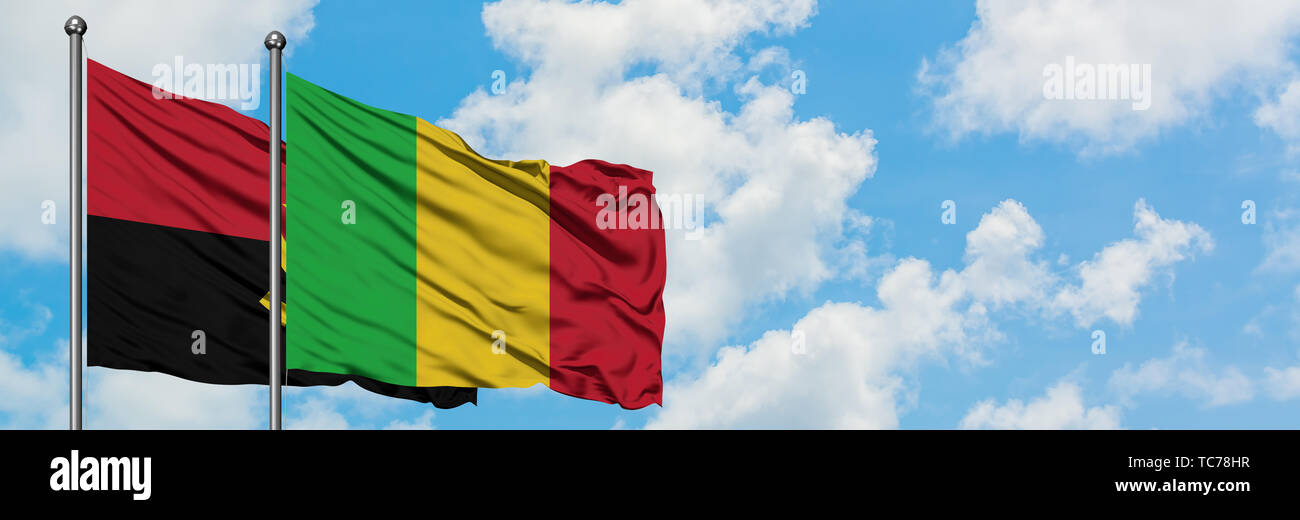 Angola and Mali flag waving in the wind against white cloudy blue sky together. Diplomacy concept, international relations. - Stock Image