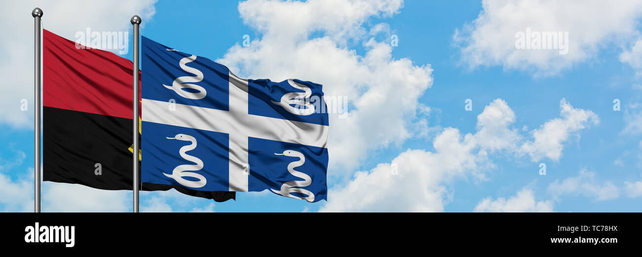 Angola and Martinique flag waving in the wind against white cloudy blue sky together. Diplomacy concept, international relations. - Stock Image