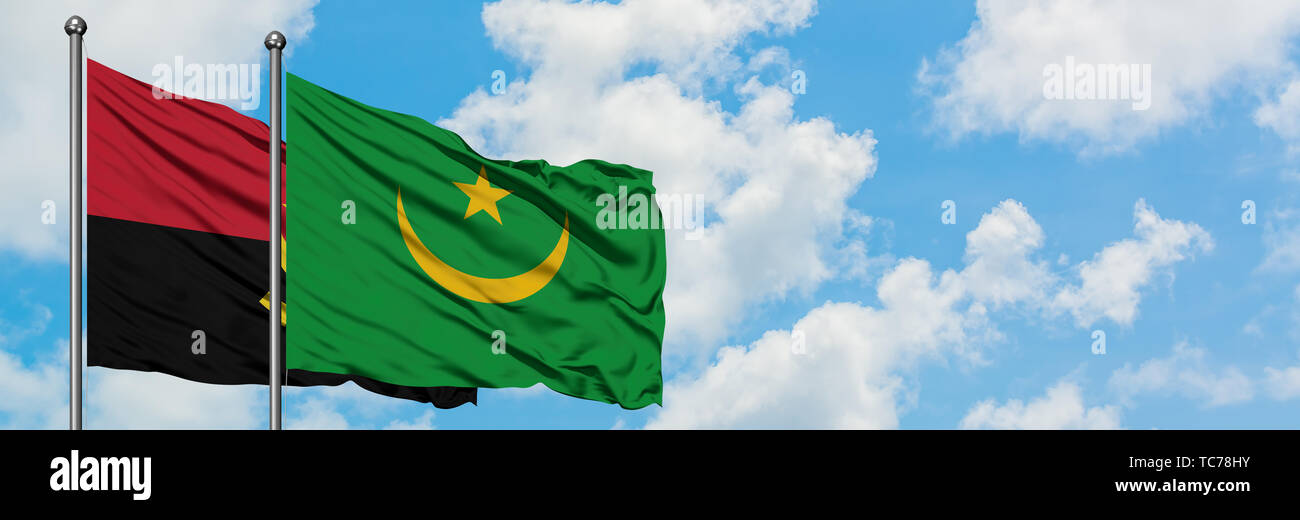 Angola and Mauritania flag waving in the wind against white cloudy blue sky together. Diplomacy concept, international relations. - Stock Image