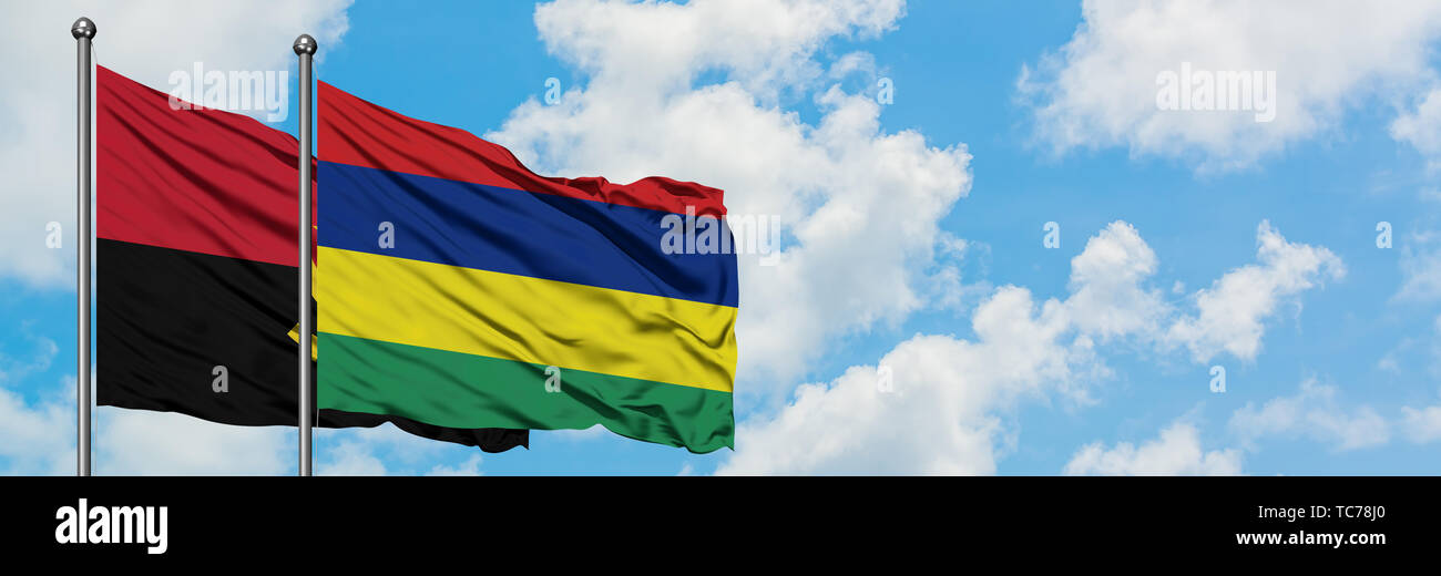 Angola and Mauritius flag waving in the wind against white cloudy blue sky together. Diplomacy concept, international relations. - Stock Image