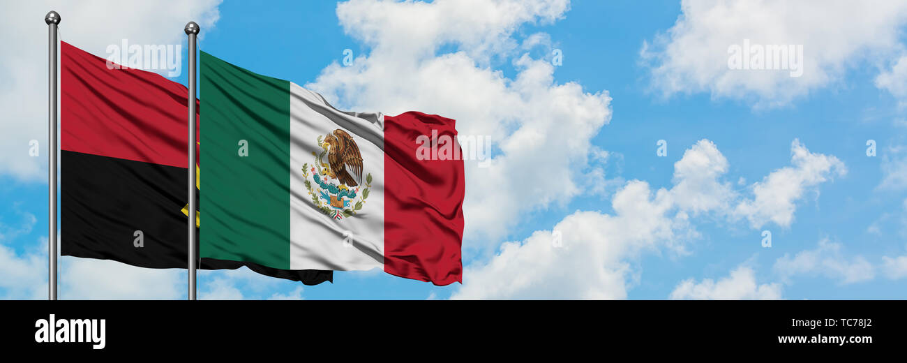 Angola and Mexico flag waving in the wind against white cloudy blue sky together. Diplomacy concept, international relations. - Stock Image