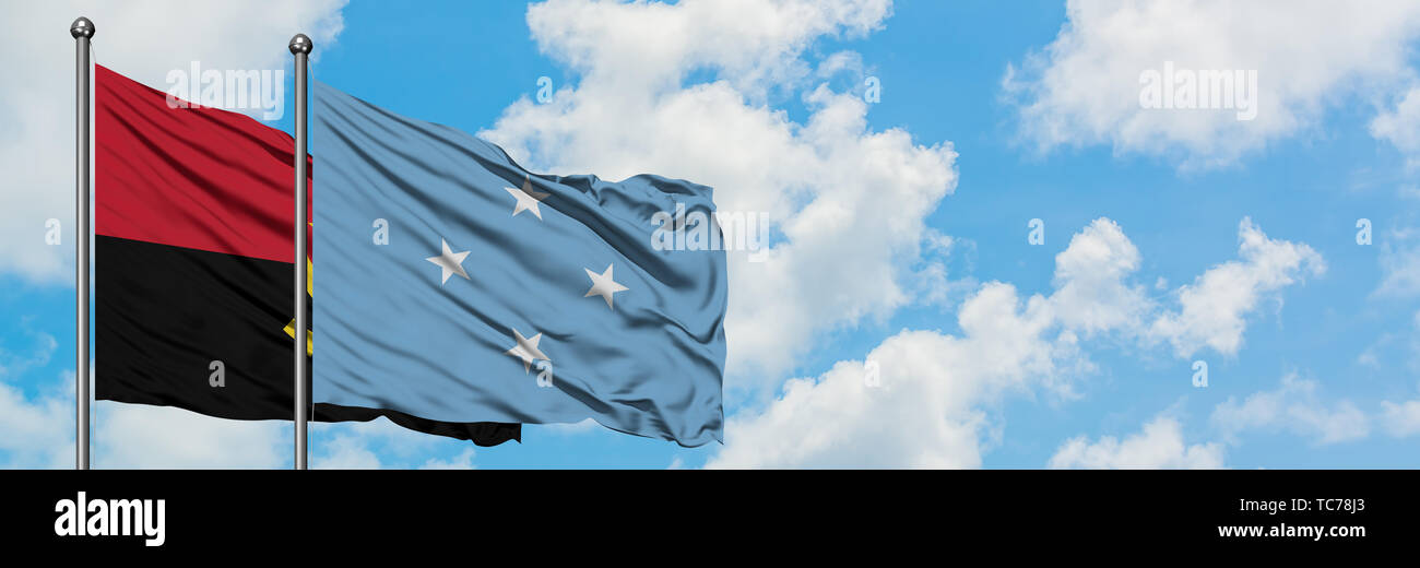 Angola and Micronesia flag waving in the wind against white cloudy blue sky together. Diplomacy concept, international relations. - Stock Image