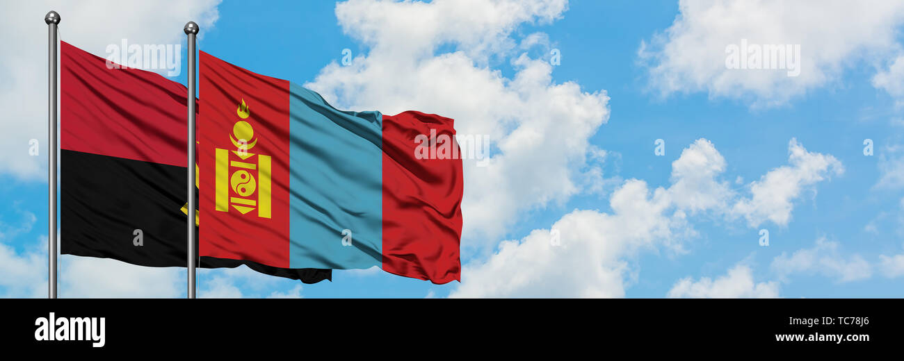 Angola and Mongolia flag waving in the wind against white cloudy blue sky together. Diplomacy concept, international relations. - Stock Image
