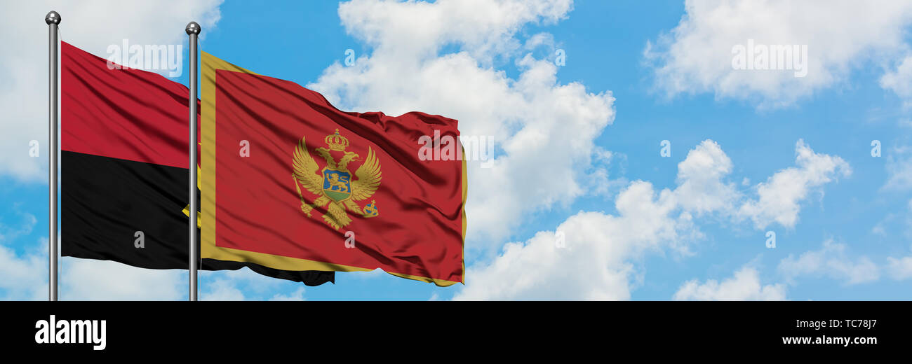 Angola and Montenegro flag waving in the wind against white cloudy blue sky together. Diplomacy concept, international relations. - Stock Image