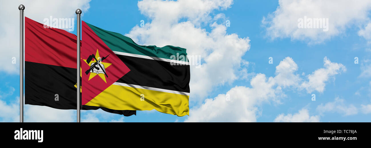 Angola and Mozambique flag waving in the wind against white cloudy blue sky together. Diplomacy concept, international relations. - Stock Image