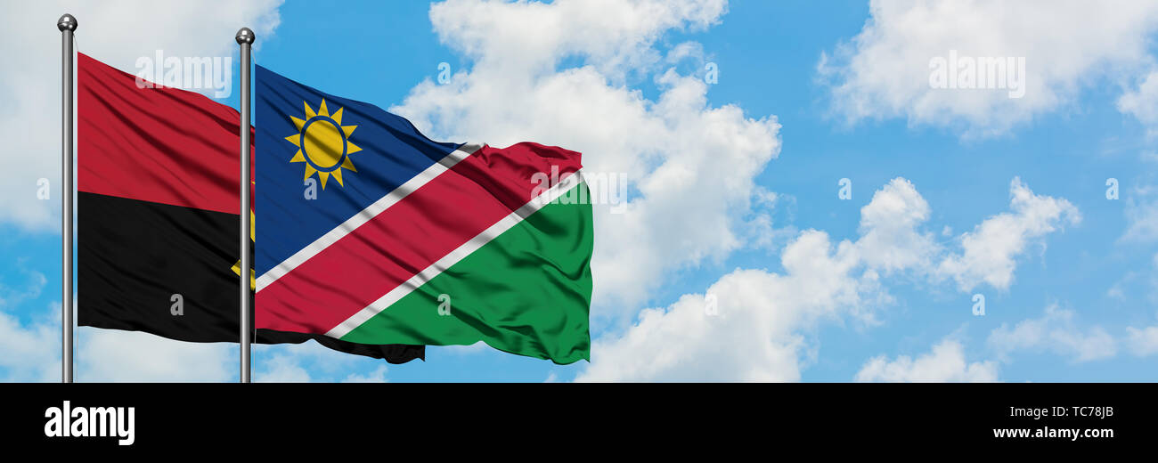 Angola and Namibia flag waving in the wind against white cloudy blue sky together. Diplomacy concept, international relations. - Stock Image