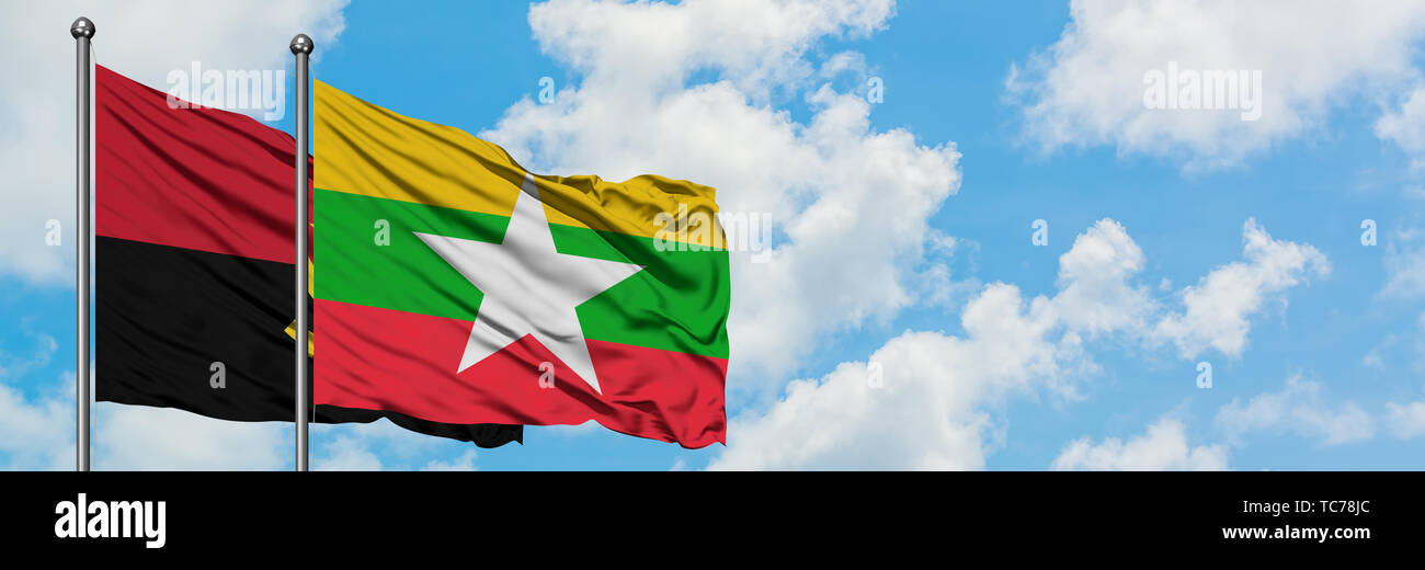 Angola and Myanmar flag waving in the wind against white cloudy blue sky together. Diplomacy concept, international relations. - Stock Image