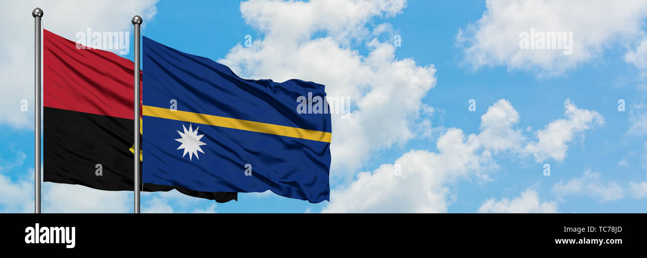 Angola and Nauru flag waving in the wind against white cloudy blue sky together. Diplomacy concept, international relations. - Stock Image