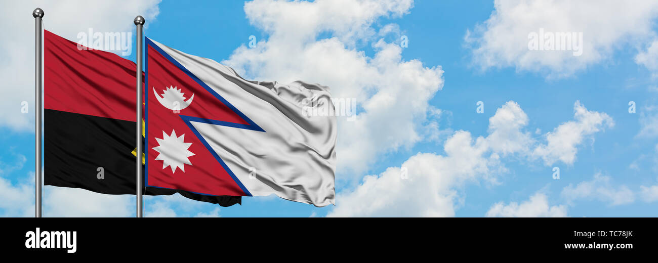 Angola and Nepal flag waving in the wind against white cloudy blue sky together. Diplomacy concept, international relations. - Stock Image